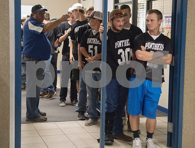 The football team waits in the hallway to be announced into the gymnasium for the first ever pep rally held at East Texas Christian Academy Friday to promote success for their 6-man football team. The ETCA football team plays King's Academy Saturday Sept. 16, 2017 at home at 1 p.m.   (Sarah A. Miller/Tyler Morning Telegraph)