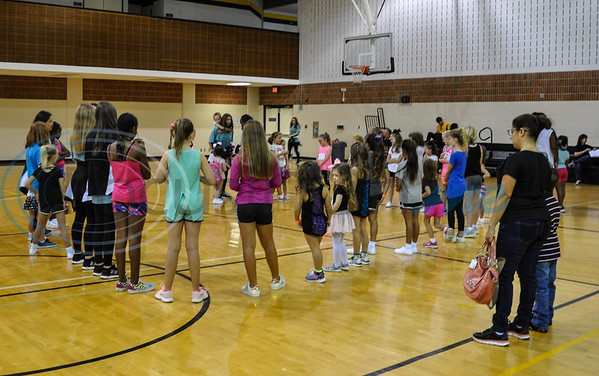 Girls gather in a circle during the Apache Belle Babe Workshop at the Ornelas Health and Physical Education Building. The workshop consisted of the girls learning an Apache Belle routine, snacks and games with the Apache Belles. (Jessica T. Payne/Tyler  Paper)