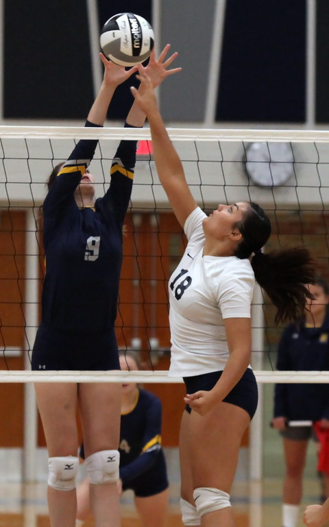 . Jamison Turay of North Ridgeville blocks the tap at the net by Lailah Carrion of Lorain during the first set. Randy Meyers -- The Morning Journal