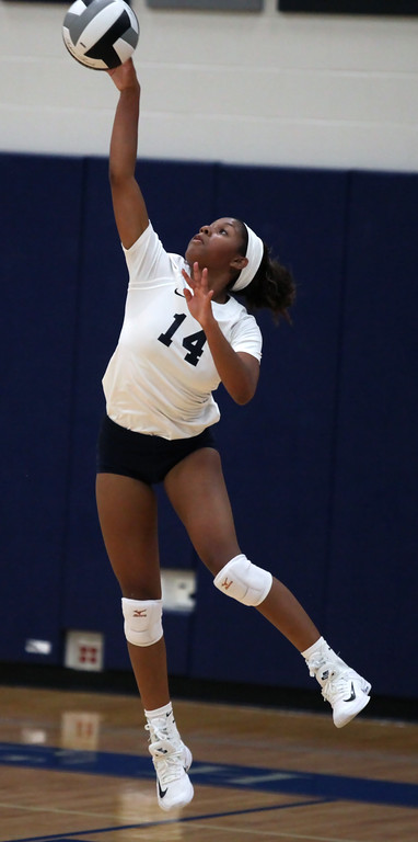 . Seven Townsel of Lorain serves during the second set against North Ridgeville. Randy Meyers -- The Morning Journal