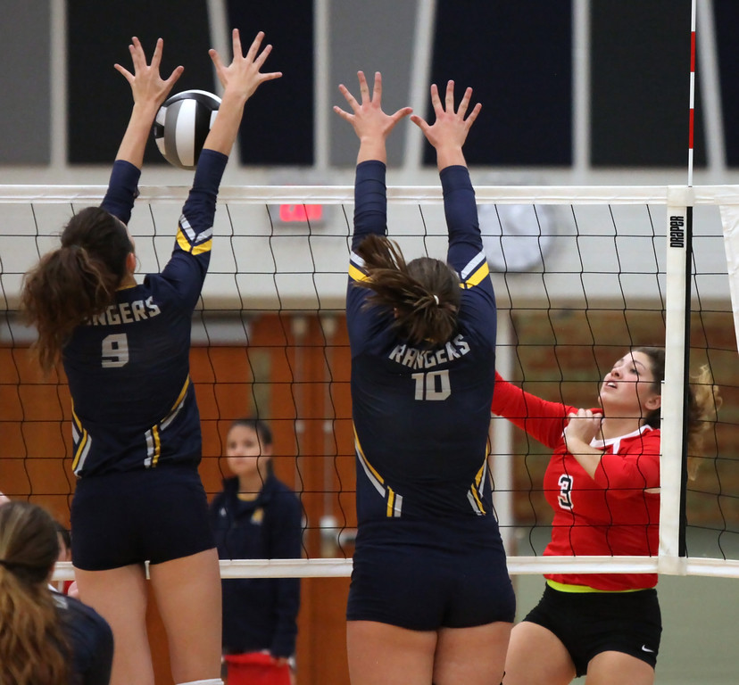 . Jamison Turay of North Ridgeville blocks the spike by Bianca Inman of Firelands. Randy Meyers -- The Morning Journal