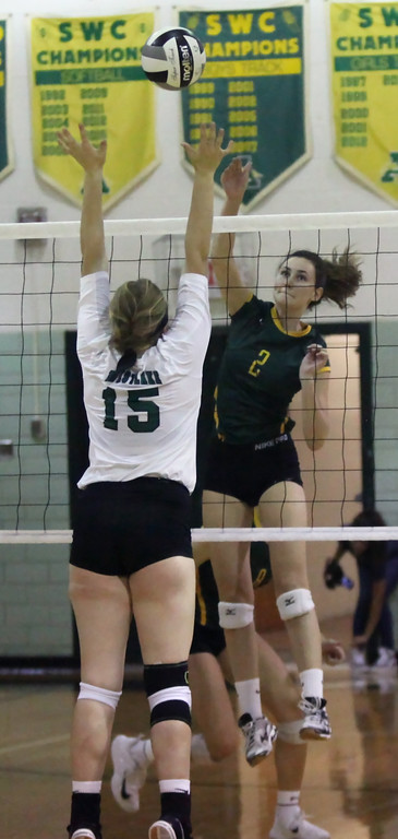 . Sarah Farley of Amherst spikes the ball over Audrey Lyle of Westlake during the second set. Randy Meyers -- The Morning Journal