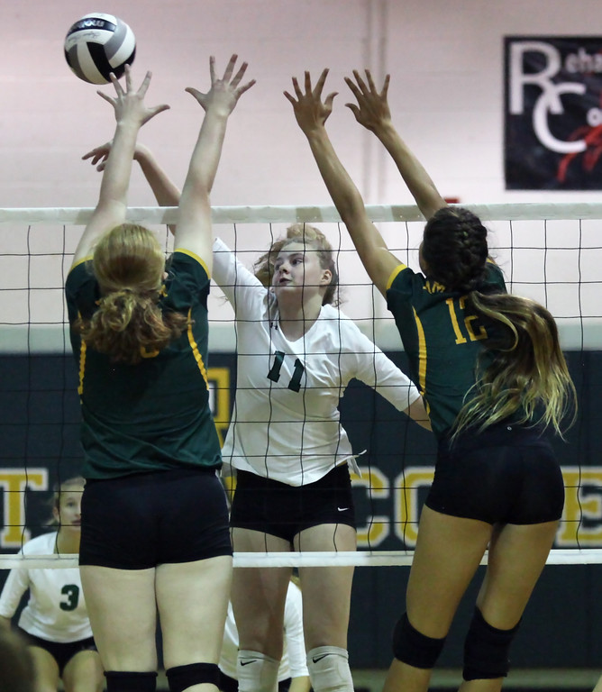 . Westlake\'s Leah Schmidt taps the ball past Tory Small and Faith Rico of Amherst during the second set. Randy Meyers -- The Morning Journal