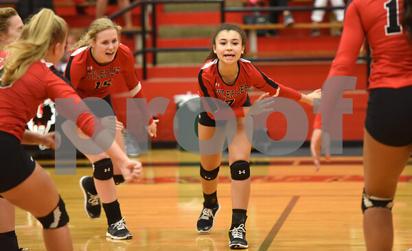 Robert E. Lee High School's Aliyah Shirley, center, celebrates a point as they play Mesquite Tuesday night Sept. 20, 2016 at home in Tyler.  (Sarah A. Miller/Tyler Morning Telegraph)