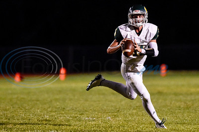 Harleton quarterback Garrett Handlin (11) looks to throw the ball during a high school football game at Union Grove High School in Gladewater, Texas, on Thursday, Sept. 20, 2018. (Chelsea Purgahn/Tyler Morning Telegraph)