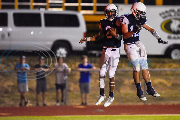 Union Grove running back Gabe Henderson (2) and wide receiver Cade Judd (12) celebrate Henderson's touchdown during a high school football game at Union Grove High School in Gladewater, Texas, on Thursday, Sept. 20, 2018. (Chelsea Purgahn/Tyler Morning Telegraph)