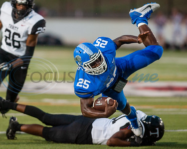 Trinity's Micah Woodley (31) takes down John Tyler's Jakyron Lacy (25) during game action Friday, Sept. 20, 2019, at Christus Trinity Mother Frances Rose Stadium in Tyler. (Cara Campbell/Tyler Morning Telegraph)