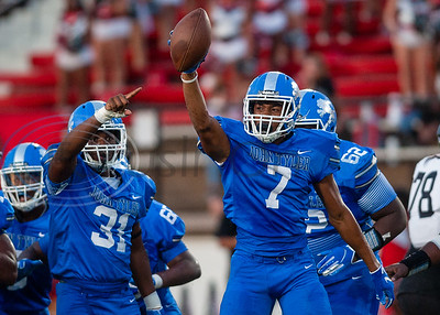 John Tyler's Travion Ates (7) celebrates after a play during game action against Trinity Friday, Sept. 20, 2019, at Christus Trinity Mother Frances Rose Stadium in Tyler. (Cara Campbell/Tyler Morning Telegraph)