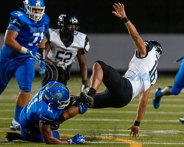 John Tyler's Kameron Mayfield (11) takes down Trinity's Valentino Foni (16) during game action Friday, Sept. 20, 2019, at Christus Trinity Mother Frances Rose Stadium in Tyler. (Cara Campbell/Tyler Morning Telegraph)