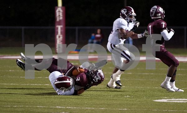photo by Sarah A. Miller/Tyler Morning Telegraph  Arp High School's senior Michael Roberson is tackled by  Troup High School's senior Wesley Thompson in the second quarter of their game at home Friday night.