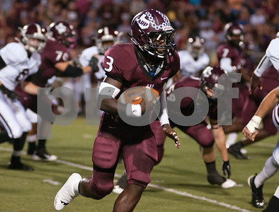 photo by Sarah A. Miller/Tyler Morning Telegraph  Arp High School's senior Michael Roberson carries the ball in the first quarter of their game at home Friday night against Troup High School.