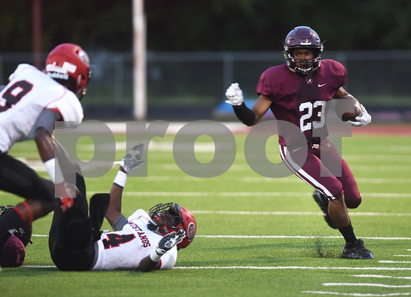Arp High School's Tray Baker carries the ball in the first quarter of their game at home against Hughes Springs Thursday September 1, 2016.  (Sarah A. Miller/Tyler Morning Telegraph)