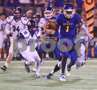 Brownsboro High School's Jamal Bell is tackled by Spring Hill's Tony Boyd during their football game at home at Bear Stadium Friday night September 2, 2016.  (Sarah A. Miller/Tyler Morning Telegraph)
