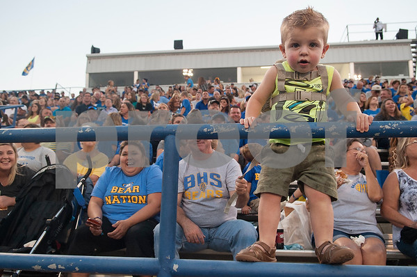 Braxton McSpedden, 1, gets a close look at the Brownsboro High School football team during their game at home at Bear Stadium against Spring Hill Friday night September 2, 2016.  (Sarah A. Miller/Tyler Morning Telegraph)