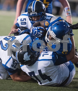 Brownsboro High School's Kevon Thompson is tackled by Spring Hill's (50) Antonio Zuniga, (52) Vaughn Bufkin and (74) Alec Thornton during their football game at home at Bear Stadium Friday night September 2, 2016.  (Sarah A. Miller/Tyler Morning Telegraph)