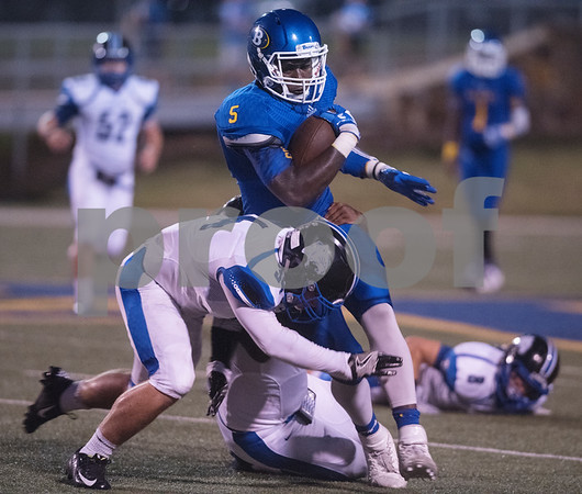Brownsboro High School's Kenneth Woods is taken down by Spring Hill's Kaden Peppers during their football game at home at Bear Stadium Friday night September 2, 2016.  (Sarah A. Miller/Tyler Morning Telegraph)