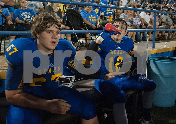 Brownsboro High School's (67) Micah Shultz, left, congratulates teammate (12) Clayton Orr after Orr made an interception in the first half of their game at home at Bear Stadium against Spring Hill Friday night September 2, 2016.  (Sarah A. Miller/Tyler Morning Telegraph)