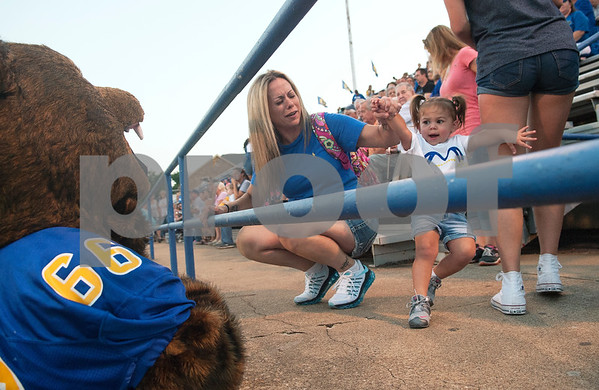 Amee Brown holds her two-year-old daughter Journee's hand as she backs away from mascot Bruno the Bear at the Brownsboro High School football game at home at Bear Stadium against Spring Hill Friday night September 2, 2016.  (Sarah A. Miller/Tyler Morning Telegraph)