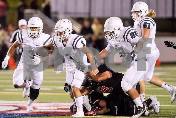 Rockwall-Heath quarterback Garrett Cody (1) runs through tackles during a high school football game at Christus Trinity Mother Frances Stadium in Tyler, Texas, on Friday, Sept. 22, 2017. (Chelsea Purgahn/Tyler Morning Telegraph)