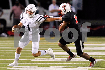 Rockwall-Heath quarterback Garrett Cody (1) runs past Robert E. Lee linebacker Oliver Hall (10) during a high school football game at Christus Trinity Mother Frances Stadium in Tyler, Texas, on Friday, Sept. 22, 2017. (Chelsea Purgahn/Tyler Morning Telegraph)
