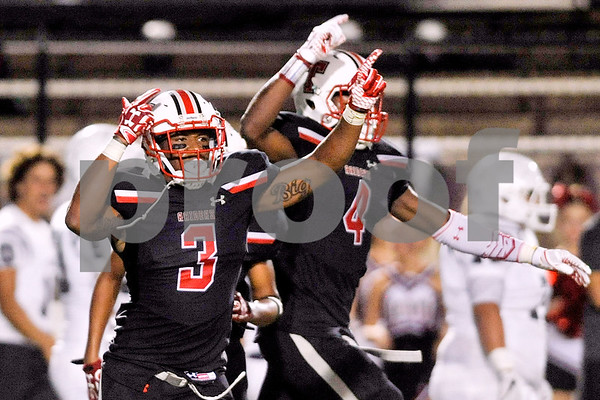 Robert E. Lee linebackers Tre'Veon McGill (3) and Lanthony Simmons (4) celebrate a fumble by Rockwall-Heath recovered by Robert E. Lee during a high school football game at Christus Trinity Mother Frances Stadium in Tyler, Texas, on Friday, Sept. 22, 2017. (Chelsea Purgahn/Tyler Morning Telegraph)