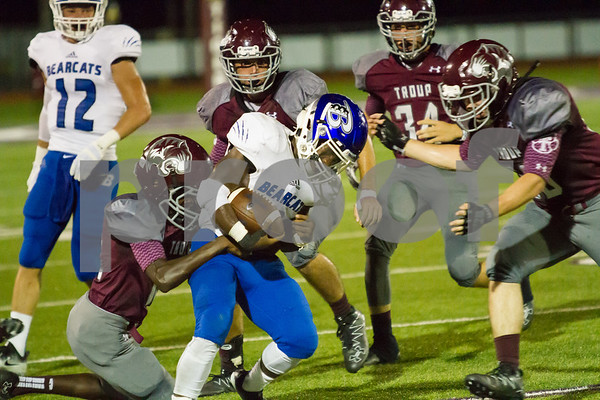 The Tiger Defense stops Becksville (3) Javon Lewis.  The Tigers hosted the Bearcats at Tiger Stadium in Tropu TX.  phot by John Murphy