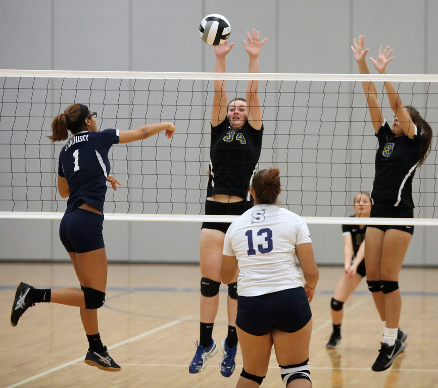 . Sandusky\'s Peyton Smith spikes the ball for point over Clearview\'s  Leanna Rogers and Madilyn Love during the first set. Randy Meyers -- The Morning Journal