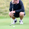 CU's Beau Schoolcraft checks the lie of his putt in the Mark Simpson Colorado Invitational at Colorado National Golf Course in Erie, Colorado September 24, 2012.  DAILY CAMERA/ MARK LEFFINGWELL