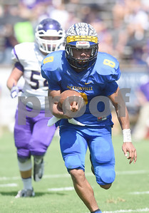 Jacksonville High School's Cameron High carries the ball in the first half of their game against Alvarado at the Tomato Bowl Saturday Sept. 24, 2016.  (Sarah A. Miller/Tyler Morning Telegraph)