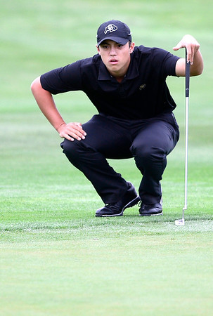 CU's Brad Oraee looks over the green before putting during the second day of the Mark Simpson Colorado Invitational at the Colorado National Golf Club in Erie, Colorado September 25, 2012.  DAILY CAMERA/ MARK LEFFINGWELL