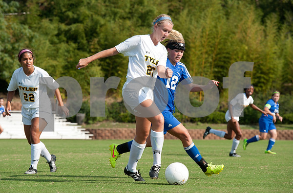photo by Sarah A. Miller/Tyler Morning Telegraph  Tyler Junior College's Keeley Bowles (26) controls the ball as she's met by Western Texas College's Jessica Lantrip (12) during their soccer match Friday Sept. 26, 2014 in Tyler.