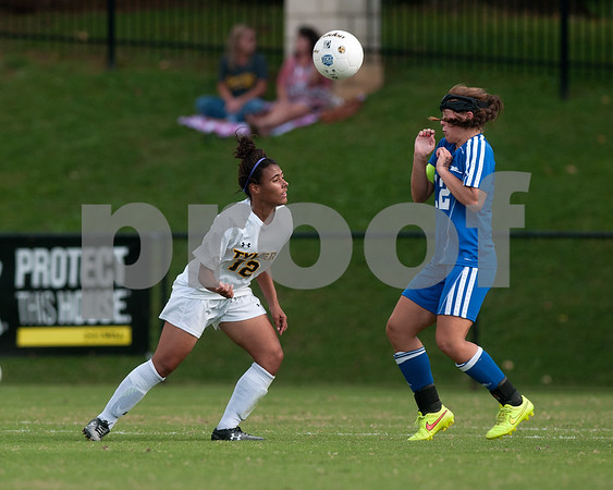 photo by Sarah A. Miller/Tyler Morning Telegraph  Tyler Junior College's Kelso Peskin (12) heads the ball as  Western Texas College's Jessica Lantrip (12) reacts Friday Sept. 26, 2014 in Tyler.