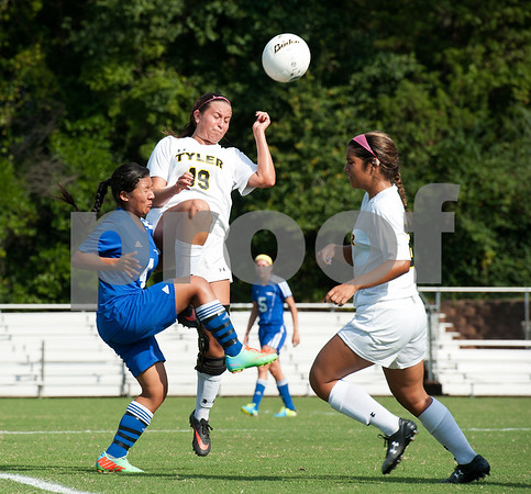 photo by Sarah A. Miller/Tyler Morning Telegraph  Tyler Junior College's Lauren Slovacek (19) heads the ball away from Western Texas College's Marta Orta (4) during their soccer match Friday Sept. 26, 2014 in Tyler.