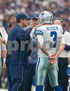 Dallas Cowboy injured quarterback Tony Romo talks with quarterback Brandon Weeden on the sideline during the second quarter of their game against the Atlanta Falcons at AT&T Stadium Sunday Sept. 27, 2015.  (Sarah A. Miller/Tyler Morning Telegraph)