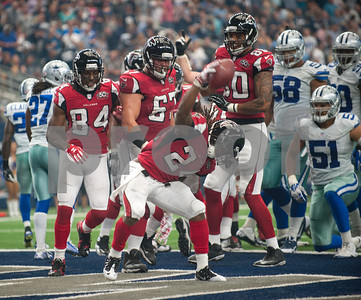 Atlanta Falcons' Devonta Freeman celebrates after scoring a touchdown in the first half of their game against the Dallas Cowboys at AT&T Stadium Sunday Sept. 27, 2015.  (Sarah A. Miller/Tyler Morning Telegraph)