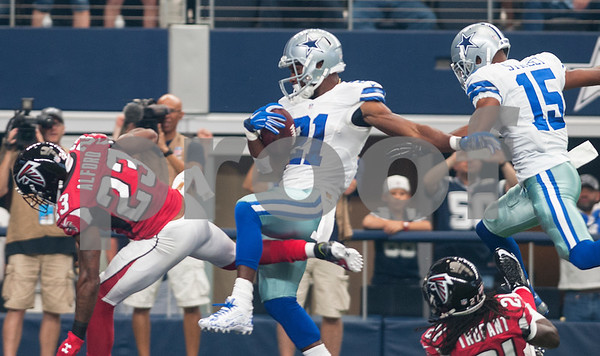 Dallas Cowboy's Joseph Randle scores a touchdown in the first half of their game against the Atlanta Falcons at AT&T Stadium Sunday Sept. 27, 2015.  (Sarah A. Miller/Tyler Morning Telegraph)