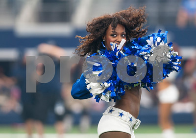 A Dallas Cowboys cheerleader performs during their game against the Atlanta Falcons at AT&T Stadium in Arlington Sunday Sept. 27, 2015.  (Sarah A. Miller/Tyler Morning Telegraph)