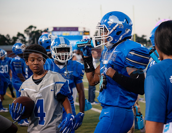 John Tyler's Travion Ates hydrates after advancing the ball during their football game against Texas High at Christus Trinity Mother Frances Rose Stadium on Friday Sept. 27, 2019.  (Sarah A. Miller/Tyler Morning Telegraph)
