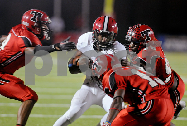 photo by Sarah A. Miller/Tyler Morning Telegraph  Mesquite Horn's quarterback junior Destri White is caught up by a group of Robert E. Lee players Friday night at Trinity Mother Frances Rose Stadium in Tyler.