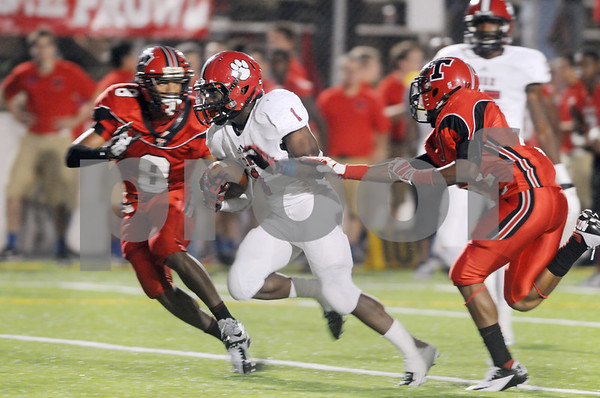 photo by Sarah A. Miller/Tyler Morning Telegraph  Mesquite Horn's senior running back Treyvon Marsh runs past Robert E. Lee's (8) senior Bryce Stewart and junior Patrick Crowder for a touchdown in the second quarter Friday night at Trinity Mother Frances Rose Stadium in Tyler.