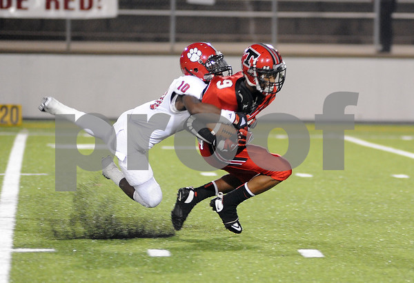 photo by Sarah A. Miller/Tyler Morning Telegraph  Mesquite Horn's (10) defensive back junior Larry Bridges tackles Robert E. Lee's (9) wide receiver junior Marquiston Williams as he heads toward the end zone Friday night at Trinity Mother Frances Rose Stadium in Tyler.