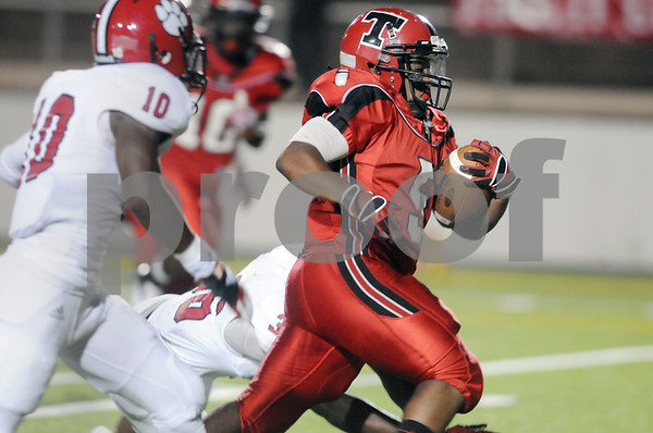 photo by Sarah A. Miller/Tyler Morning Telegraph  Robert E. Lee's senior fullback Marcus White carries the ball for a touchdown in the first half Friday night against Mesquite Horn at Trinity Mother Frances Rose Stadium in Tyler.