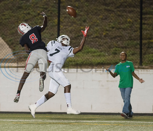 Robert E. Lee High School's Te'Vion Massey and Rockwall-Heath High School's Tre Burns attempt to catch the ball at Christus Trinity Mother Frances Rose Stadium in Tyler on Friday Sept. 28, 2018.  (Sarah A. Miller/Tyler Morning Telegraph)