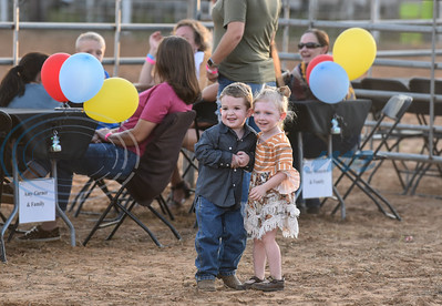 Young children smile while attending the 2019 Nicky Wheeler Memorial Bull Riding event in Jacksonville. Forty bull riders competed in the event which took place on Saturday, September 28. (Jessica T. Payne/Tyler Morning Telegraph)