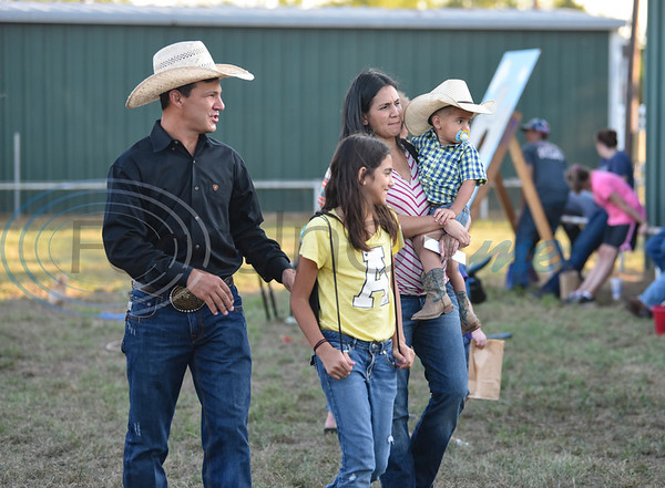 A family attends the 2019 Nicky Wheeler Memorial Bull Riding on Saturday, September 28. The event took place in Jacksonville where the proceeds fund scholarships for Cherokee County youth involved in 4-H and FFA. (Jessica T. Payne/Tyler Morning Telegraph)