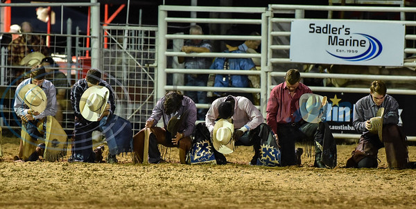Bull riders kneel during a prayer at the 2019 Nicky Wheeler Memorial Bull Riding event in Jacksonville. Forty bull riders competed in the event which took place on Saturday, September 28. (Jessica T. Payne/Tyler Morning Telegraph)