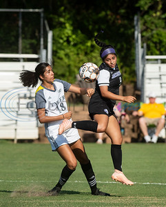 Jacksonville College's Katherine Martinez (9) heads the ball away from Tyler Junior College's Alexia Moreira (18) heads the ball during their soccer match against Jacksonville College on Tuesday Sept. 3, 2019 at Pat Hartley Field.  (Sarah A. Miller/Tyler Morning Telegraph)