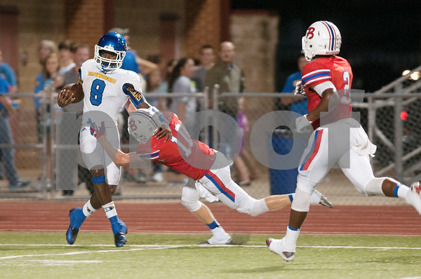 Bullard's Drake Daly (10) tackles Brownsboro's Tamrick Pace (8) in the first half of their game at home Friday night Sept. 4, 2015.  (Sarah A. Miller/Tyler Morning Telegraph)
