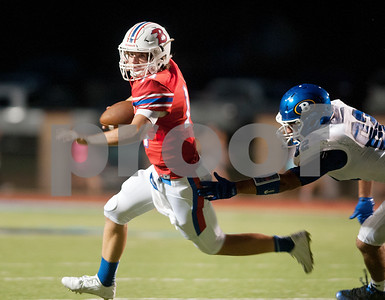 Bullard's Hood Taylor (14) is chased by Brownsboro's Caleb Seal in the first half of their game at home Friday night Sept. 4, 2015.  (Sarah A. Miller/Tyler Morning Telegraph)