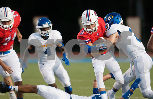 Bullard's Nic Costas (9) is tackled by Brownsboro's Wyatt Rinehart in the first half of their game at home Friday night Sept. 4, 2015.  (Sarah A. Miller/Tyler Morning Telegraph)